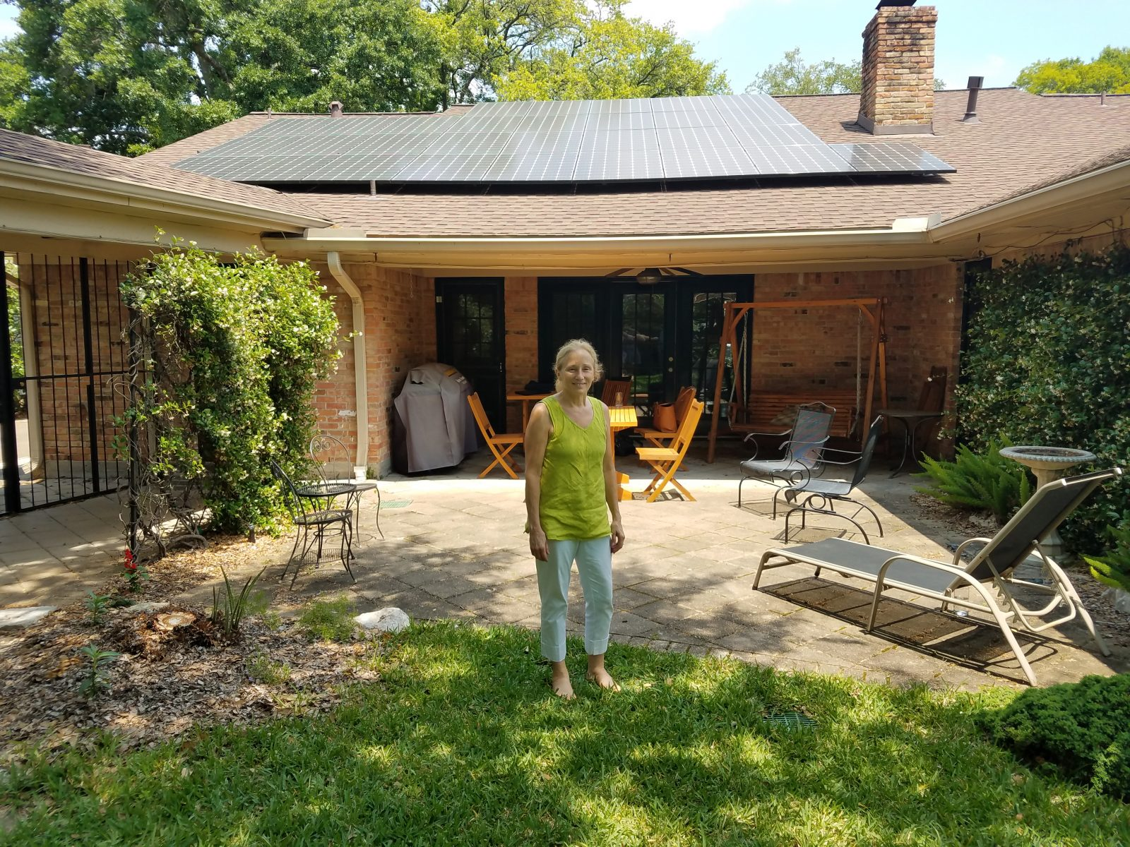 Dori Wolfe, one of the exhibitors in the Industry Showcase, leads CEBN staff on a tour of net zero home energy solutions the day after the forum.