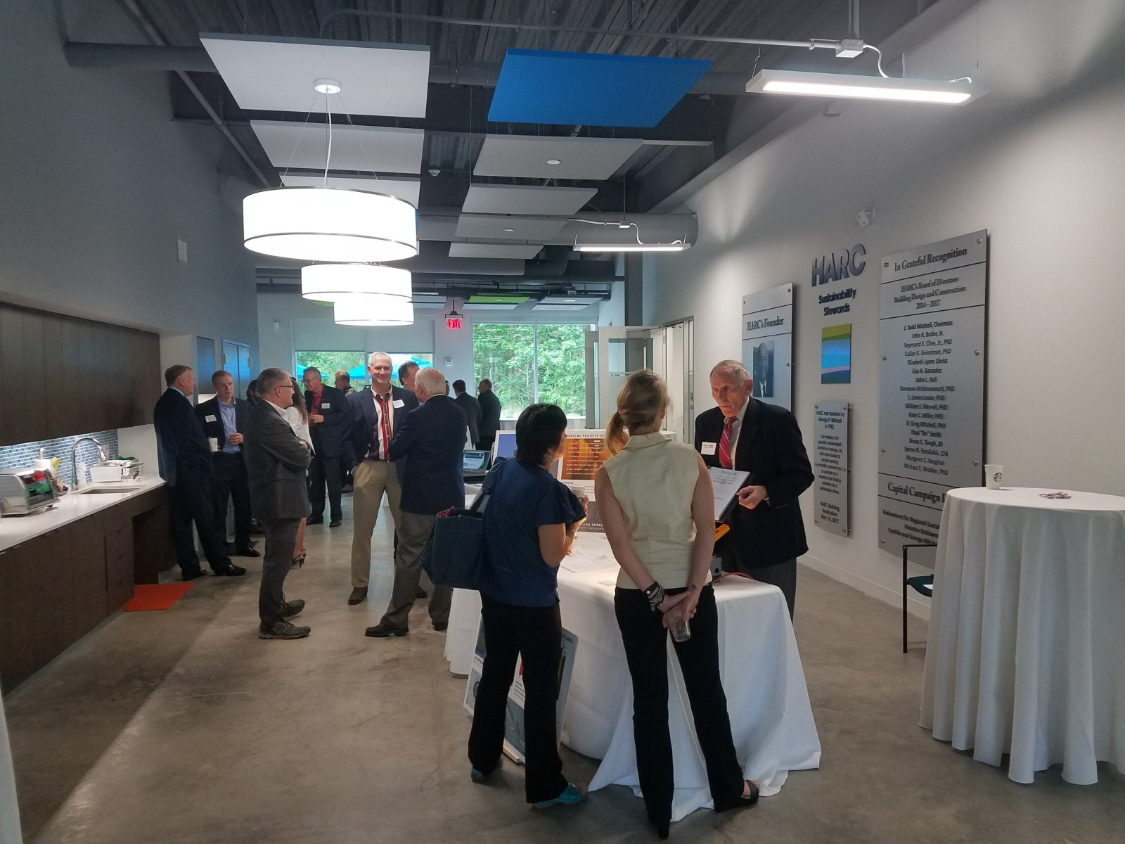 Guests gather around the small business exhibitors at the Industry Showcase.